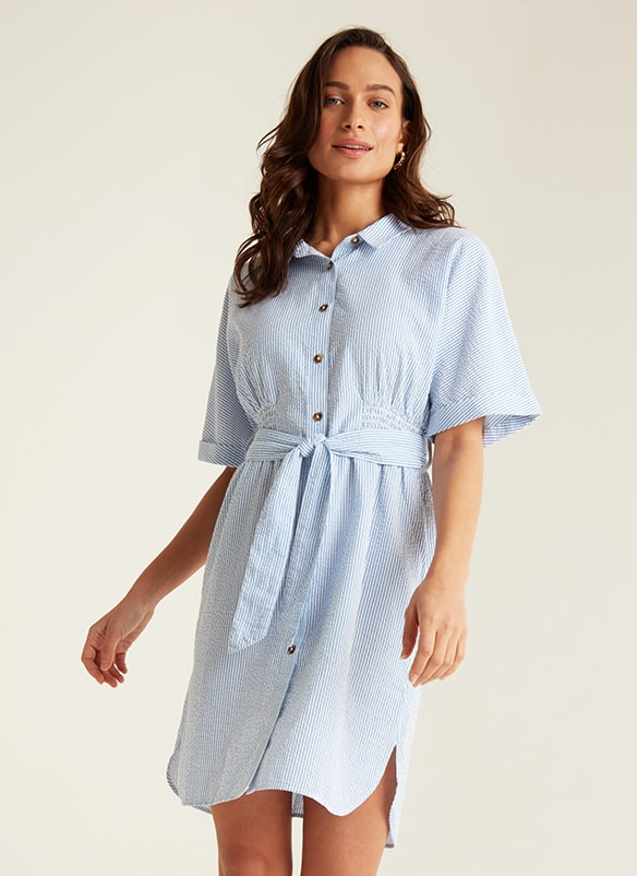 Short sleeve shirt dress with thin pale blue and white stripes and wide fabric tie belt