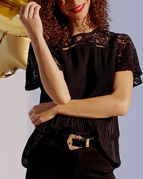 Short sleeve, sheer black pleated top with lace yoke and sleeves