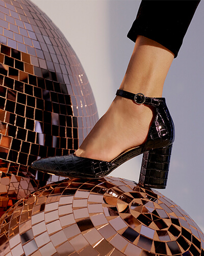Black faux croc skin shoes with chunky heels, pointed toes and buckle ankle strap