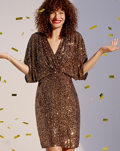Gold sequin, above-the-knee dress with twist wrap over front, fitted waist and wide, elbow-length sleeves
