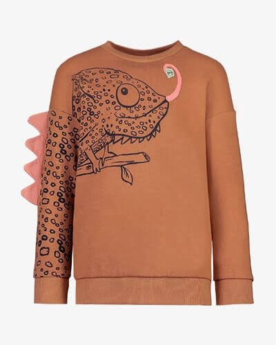 Burnt orange sweater with large black line drawing of quirky chameleon across right sleeve and chest, with 3D fabric spike shapes on right sleeve