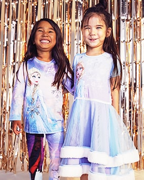 Purple, pink and blue tie-dye style, fleecy long sleeve pyjamas with Elsa on front. Blue turning to purpley-pink short sleeve long nightdress with Elsa on front, and 2 flared mesh layers edged with white fleece