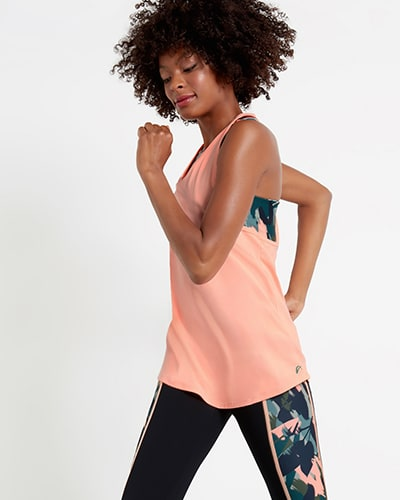 Top vest layer is coral with coral camo print underneath