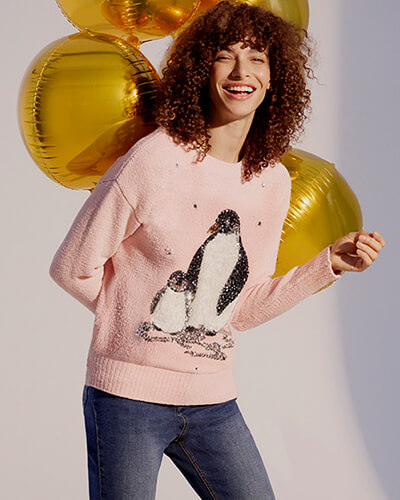 Powder pink jumper with adult and baby penguin. Penguins have sequin head and wings, and white fleece bodies