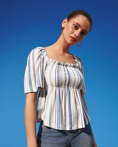 Cream, square neck, short sleeve top with vertical blue stripes