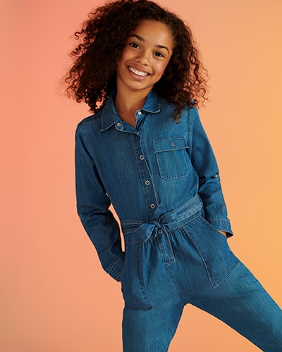 Denim boiler suit with side pockets and one chest pocket, and fabric self-tie belt